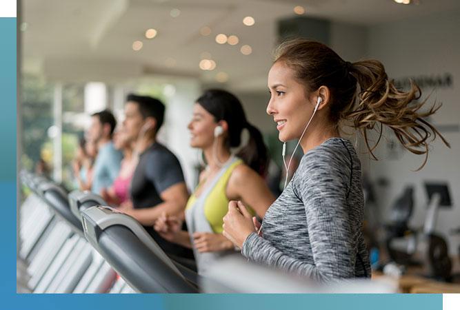 men and women on treadmills
